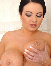 See big tits babe Marille's boobs covered in cream & washed