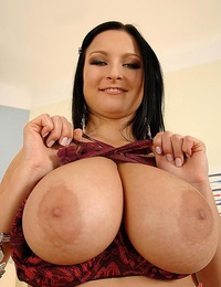 Busty Lucy Diamonds gets rid of her lingerie with pleasure