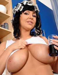 Big boobed Kora pours milk over her big jugs & rubs her tits